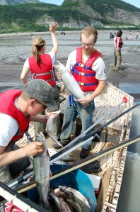 Offloading a good catch and swapping fishermen and women.