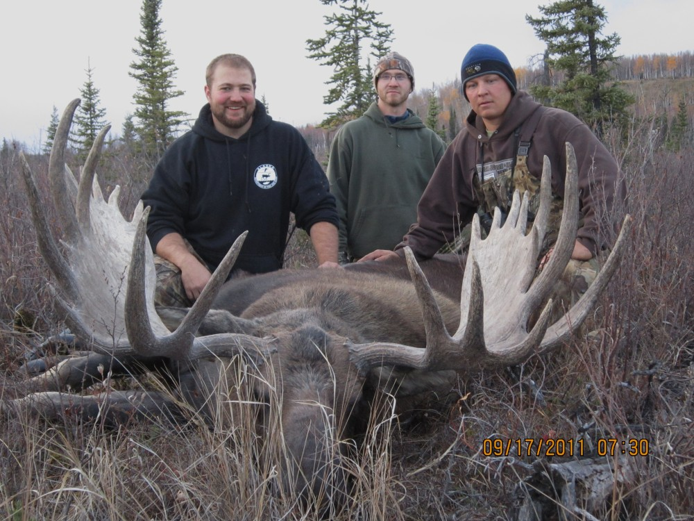 """Justin, Jared, and Jacob with Justin's 57"""" bull!"""